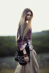 Beautiful hippie girl on nature of evening. Boho fashion style