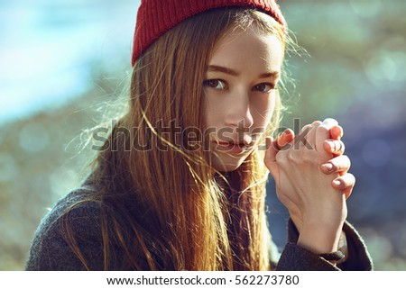 beautiful hipster girl outdoors. girl dressed in a coat. fall style  #562273780