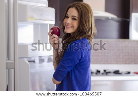 Beautiful hispanic brunette eating healthy