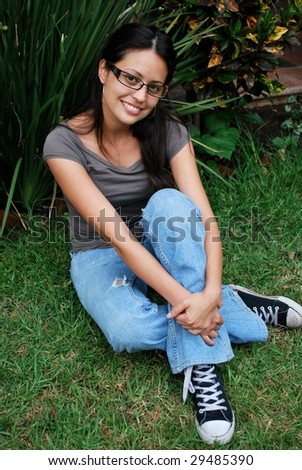 Beautiful Hispanic student sitting outside