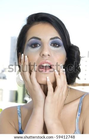 Beautiful Hispanic woman with a look of astonishment - stock photo