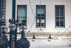 Beautiful historic building with old large windows, outdoor lights in a historic place of Denver city.