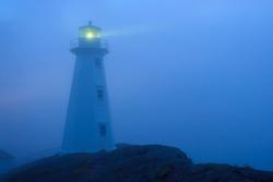 Beautiful historic Lighthouse on the Atlantic Coast in morning fog.