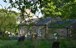 Beautiful historic stone church and graveyard in Northern England.