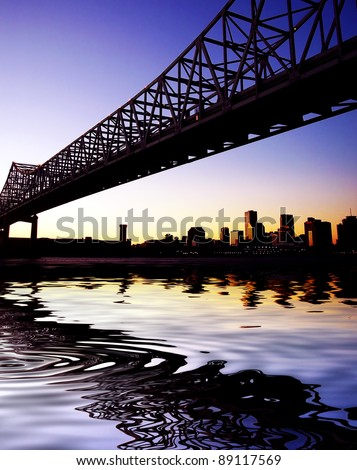 Beautiful historical Crescent City Connection Bridge in New Orleans Louisiana. Skyline, cityscape with reflection in water.