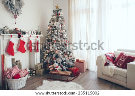 Beautiful holdiay decorated room with Christmas tree with presents under it #235115002