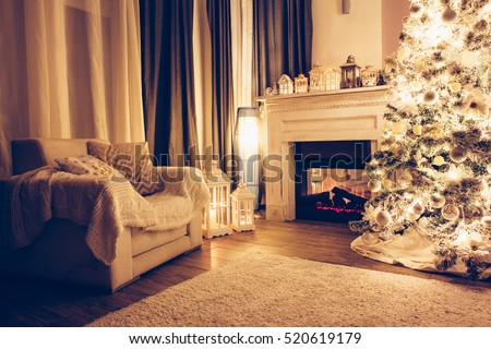 Beautiful holiday decorated room with Christmas tree, armchair and fireplace at night. Led lighting, cozy home scene. Nobody there.