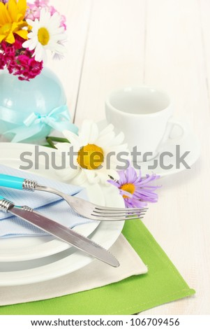 beautiful holiday table setting with flowers - stock photo