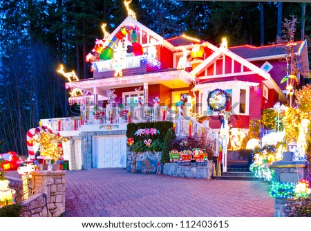 Beautiful home decorated and lighted for Christmas and for New Year Eve at Night at Vancouver, Canada.