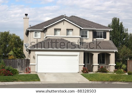 Beautiful home in suburban neighborhood - stock photo