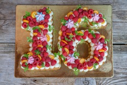 beautiful homemade birthday cake in the form of the number sixteen. the view from the top