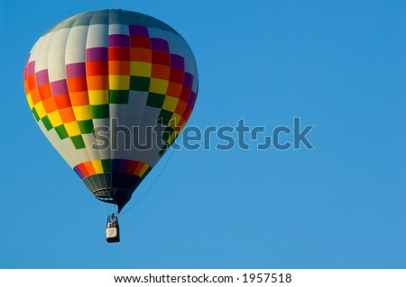Beautiful hot air balloon against dark blue sky with basket