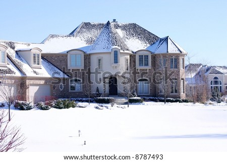 Beautiful house covered in snow - stock photo