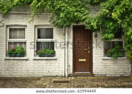 Beautiful house front in one of london's cozy mews. - stock photo