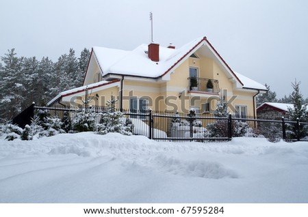 Beautiful house in snowy scenery of polish forest