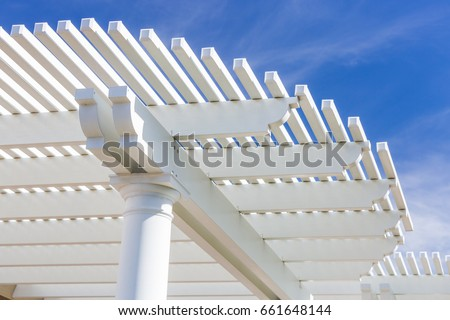 Beautiful House Patio Cover Against the Blue Sky. #661648144