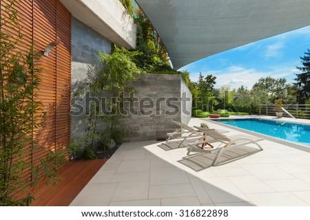 beautiful house, swimming pool view from the veranda, summer da
