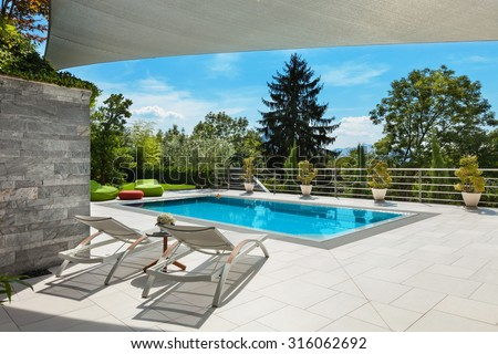 beautiful house, swimming pool view from the veranda, summer day