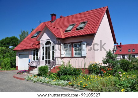 Beautiful house with red roof.