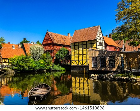 Photo of  Beautiful houses by a river in Aarhus, Denmark - Den Gamle By