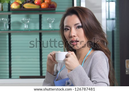 Beautiful housewife preparing food, coffee and bread.
