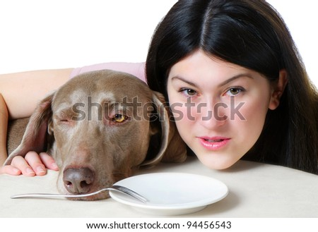 Beautiful hungry young woman and dog