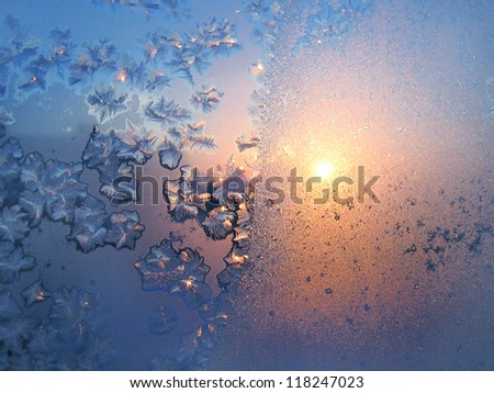 Beautiful ice pattern and sunlight on winter glass