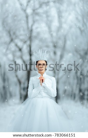 Stock Photo Beautiful Ice Queen in Winter Wonderland. Portrait of pretty ice princess in fantasy story tale