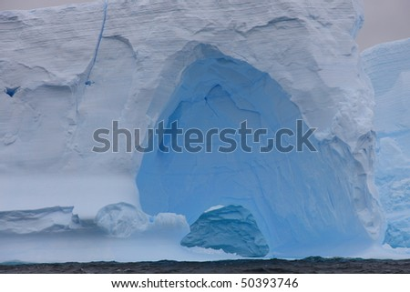 Beautiful iceberg in Antarctica seen from a sailing boat
