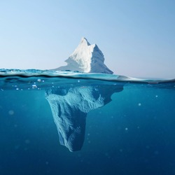 Beautiful iceberg in the ocean with a view under water. Global warming concept. Melting glacier
