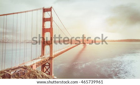 Beautiful icon of San Francisco. Iconic place of San Francisco. The Golden Gate Bridge in vintage tone. Warm soft light.