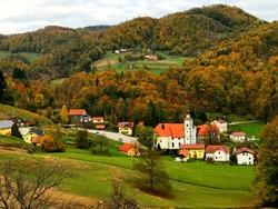 Beautiful idyllic rural landscape, Slovenia. Picturesque idyllic village of Olimje. Scenic slovenian countryside. Green hills. Autumn forest. Stunning nature. Wonderful peaceful land. Natural beauty.
