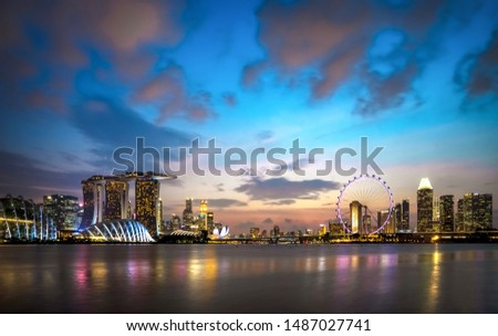 Beautiful illumianted Cityscape of Singpore at Marina Bay area during sunset Buildings at Gardens by the Bay in Singapore City.