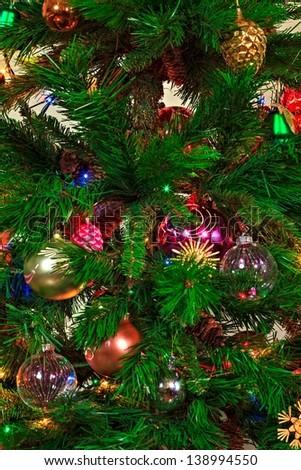 Beautiful illuminated christmas tree with toys