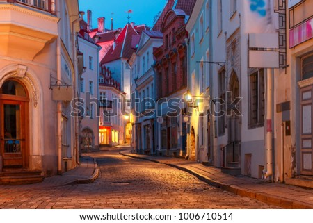 Beautiful illuminated medieval street in Old Town of Tallinn during evening blue hour, Estonia #1006710514