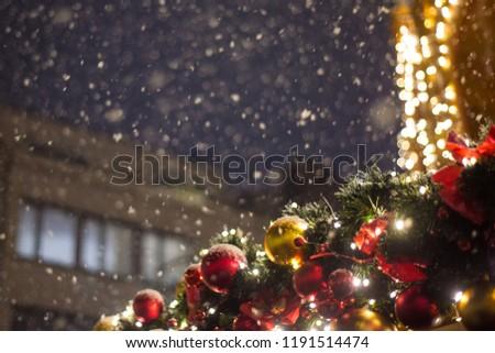 Beautiful illumination at the Christmas market during a snowfall