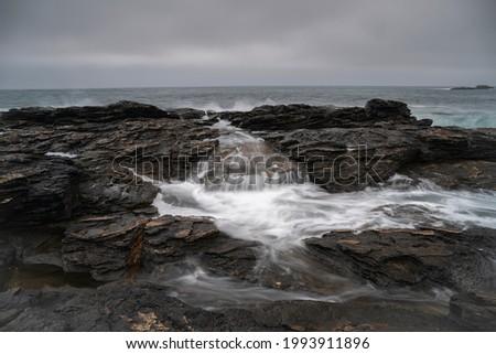 Beautiful image of sea water seeping between the rocks of the coast. Stok fotoğraf ©