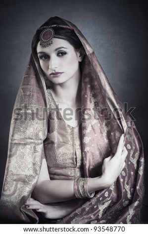 Beautiful Indian brunette portrait with traditional costume.