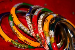 Beautiful Indian colorful bangles for women, bangles stack, colorful background, shiny bangles, decorated with stones.