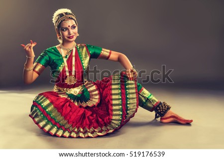Beautiful indian girl dancer in the posture of Indian dance . Indian classical dance bharatanatyam .