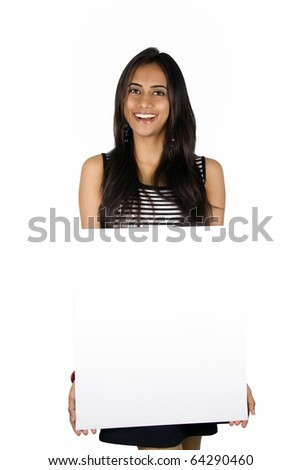 Indian girl holding a white board.. Isolated on a white background ...