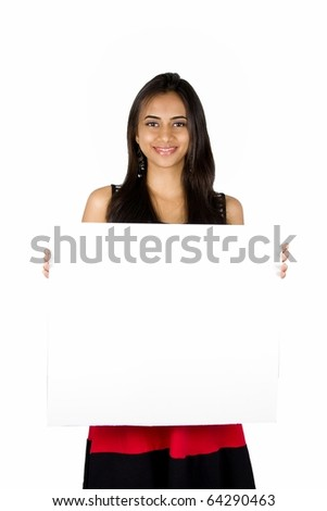 Beautiful Indian girl holding a white board.. Isolated on a white background.
