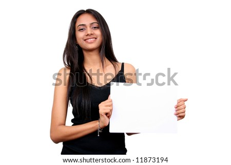 Beautiful Indian girl holding a white sign.
