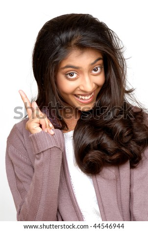 beautiful indian girl pointing on white background - stock photo