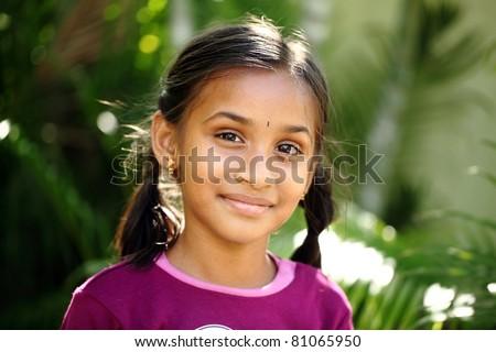 Beautiful Indian girl posing to the camera / Indian girl / Indian girl