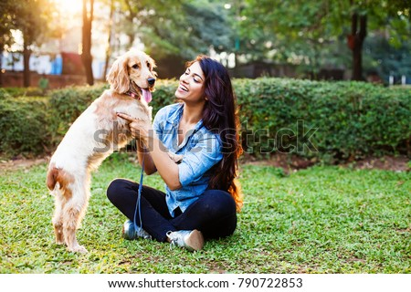 Beautiful indian girl with her cocker spaniel dog #790722853