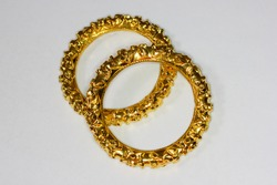 Beautiful Indian style gold bangles/jewelry laying on white background