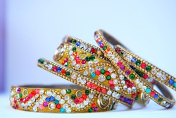 Beautiful Indian traditional bangles, bangles for women, decorated with colorful stones, isolated on white background.