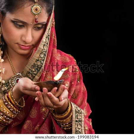 0ad03e4a67 Beautiful Young Indian Woman in red Traditional Clothing with perfect Makeup  and Oriental Jewelry. Beautiful · Beautiful Indian woman hands holding diya  oil ...