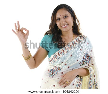 Beautiful Indian woman showing okay hand sign on white background